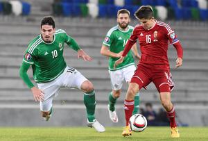 Northern Ireland's striker Kyle Lafferty (L) vies with Hungary's midfielder Adam Nagy during the Euro 2016 qualifying group F football match between Northern Ireland and Hungary at Windsor Park in Belfast on September 7, 2015. AFP PHOTO / MICHAEL COOPERMichael Cooper/AFP/Getty Images