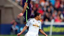 Manchester City's Pablo Zabaleta (top) and Swansea City's Jefferson Montero battle for the ball during the Barclays Premier League match at the Liberty Stadium, Swansea. David Davies/PA Wire.