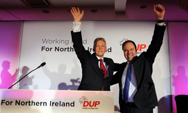 DUP Leader Peter Robinson with Deputy Leader Nigel Dodds (right) at the Democratic Unionist Party (DUP) annual conference at the La Mon Hotel Co Down. Picture date: Saturday November 23, 2013. Photo by Paul Faith