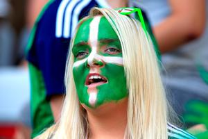 A Northern Ireland fan shows her support in the stands before the UEFA Euro 2016, Group C match at the Stade de Nice, Nice.