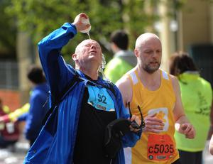 PACEMAKER BELFAST   03/05/2015 Runners cooling down  on the Antrim Road   during the Belfast Marathon 2015 takes place on Bank Holiday monday. Photo Colm Lenaghan/Pacemaker