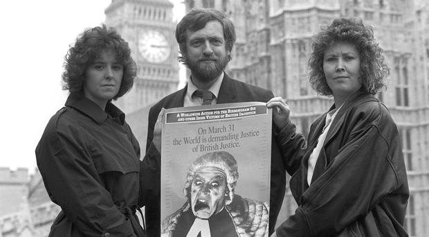 Jeremy Corbyn with members of a Birmingham Six protest group (PA)