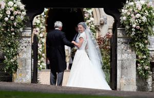 The Duchess of Cambridge's sister Pippa Middleton arrives with their father Michael Middleton, at St Mark's church in Englefield, Berkshire, for her wedding to her millionaire groom James Matthews at an event dubbed the society wedding of the year. PRESS ASSOCIATION Photo. Picture date: Saturday May 20, 2017. See PA story ROYAL Pippa. Photo credit should read: Kirsty Wigglesworth/PA Wire