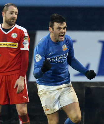 Three and easy: Glenavon's Eoin Bradley celebrates after scoring the second goal of his hat-trick