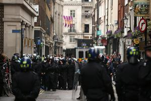 LONDON, ENGLAND - JUNE 11:  Police are seen on Beak Street to diffuse anti G8 protesters potentially becoming violent, as they reportedly occupy a Police Station ahead of next week's G8 summit in Northern Ireland on June 11, 2013 in London, England. Next week will see Enniskillen in Northern Ireland host the two day G8 summit where international leaders including Britain's Prime Minister David Cameron and US President Barack Obama take part in the two day event. The chosen location is only 8 kilometers from the scene of one of Northern Ireland's worst killings back in 1987, however Cameron is confident that it's secluded location will deter any potential trouble.  (Photo by Dan Kitwood/Getty Images)