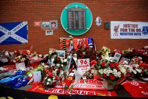 LIVERPOOL, ENGLAND - APRIL 15:  Tributes are left outside Anfield stadium before a memorial service to mark the 27th anniversary of the Hillsborough disaster, on April 15, 2016 in Liverpool, England. Thousands of fans, friends and relatives will take part in the final Anfield memorial service for the 96 victims of the Hillsborough disaster. Earlier this year relatives of the victims agreed that this year's service would be the last. Bells across the City of Liverpool will ring out during a one minute silence in memory of the 96 Liverpool supporters who lost their lives during a crush at an FA Cup semi-final match against Nottingham Forest at the Hillsborough football ground in Sheffield, South Yorkshire in 1989.  (Photo by Christopher Furlong/Getty Images)