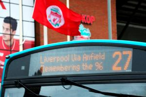 LIVERPOOL, ENGLAND - APRIL 15:  A bus displays a message reading 'Remembering the 96' next to it's route information as it drives past Anfield stadium before a memorial service to mark the 27th anniversary of the Hillsborough disaster, on April 15, 2016 in Liverpool, England. Thousands of fans, friends and relatives will take part in the final Anfield memorial service for the 96 victims of the Hillsborough disaster. Earlier this year relatives of the victims agreed that this year's service would be the last. Bells across the City of Liverpool will ring out during a one minute silence in memory of the 96 Liverpool supporters who lost their lives during a crush at an FA Cup semi-final match against Nottingham Forest at the Hillsborough football ground in Sheffield, South Yorkshire in 1989.  (Photo by Christopher Furlong/Getty Images)