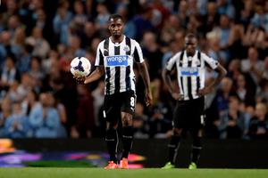 MANCHESTER, ENGLAND - AUGUST 19:  (L-R) Dejected newcastle teammates Vurnon Anita and Mapou Yanga-Mbiwa look on after conceding four goals during the Barclays Premier League match between Manchester City and Newcastle United at the Etihad Stadium on August 19, 2013 in Manchester, England.  (Photo by Michael Regan/Getty Images)