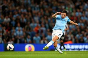 MANCHESTER, ENGLAND - AUGUST 19:  Samir Nasri of Manchester City scores the fourth goal during the Barclays Premier League match between Manchester City and Newcastle United at the Etihad Stadium on August 19, 2013 in Manchester, England.  (Photo by Alex Livesey/Getty Images)