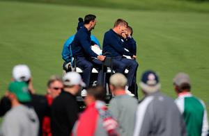 Europe's Martin Kaymer and Europe vice captain Ian Poulter on a buggy after the morning Foursomes during day one of the 41st Ryder Cup at Hazeltine National Golf Club in Chaska, Minnesota, USA. Peter Byrne/PA Wire.