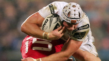Blocked: Ulster's Luke Marshall is tackled by Andrew Conway