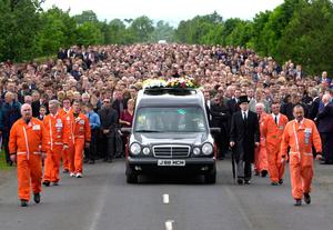 Joey Dunlop funeral July 2000 Thousands of fans attended motorbike ace Joey Dunlop's funeral today at Garryduff, Ballymoney.