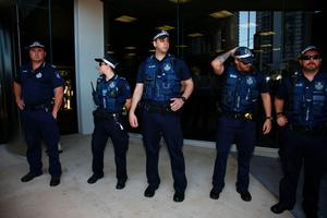 A police presence is seen outside the courthouse before the arrival of US actor Johnny Depp and his wife Amber Heard in the Gold Coast on April 18, 2016.  Depp and his wife Amber Heard arrived at an Australian court April 18 over Heard's alleged illegal importation of their two Yorkshire terrier dogs Boo and Pistol into the country in a private jet in 2015, as Depp was in Australia for the filming of the latest Pirates of the Carribean movie.    / AFP PHOTO / Patrick HAMILTONPATRICK HAMILTON/AFP/Getty Images