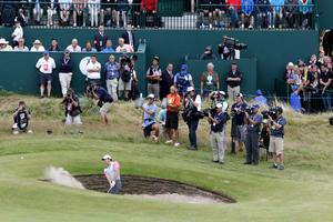 Northern Ireland's Rory McIlroy chips out of the bunker on the 18thduring day four of the 2014 Open Championship at Royal Liverpool Golf Club, Hoylake.