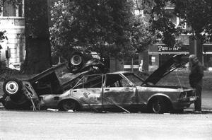Police forensic officers working on the remains of the IRA car which housed the Hyde Park car bomb in which four soldiers died in London in 1982.