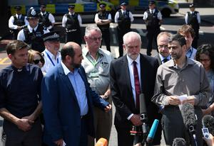 LONDON, ENGLAND - JUNE 19:  Labour leader Jeremy Corbyn (C-R) looks on as community and religious leaders speak at the scene of a terror attack in Finsbury Park in the early hours of this morning, on June 19, 2017 in London, England. Worshippers were struck by a hired van as they were leaving Finsbury Park mosque in North London after Ramadan prayers. One person was killed in the terror attack with a further 10 people injured.  (Photo by Carl Court/Getty Images)