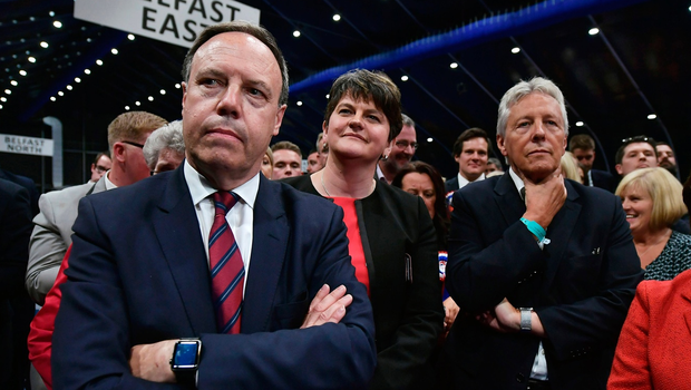 DUP leader Arlene Foster (2nd L), DUP deputy leader and north Belfast candidate Nigel Dodds (L), former DUP leader and Northern Ireland First Minister Peter Robinson (R) watch on at the Belfast count centre on June 9, 2017 in Belfast, Northern Ireland.  (Photo by Charles McQuillan/Getty Images)