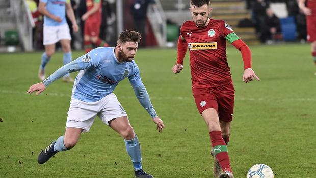 PACEMAKER BELFAST 21/01/2020 Cliftonville v Ballymena County Antrim Shield Final Cliftonville's Conor McMenamin  and Ballymena's  James Knowles during this evening's game at Windsor Park in Belfast. Photo Colm Lenaghan/Pacemaker Press