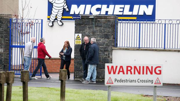 Staff discuss the impact of the announcement at the Michelin tyre factory in Ballymena. Picture Presseye Jonathan Porter.