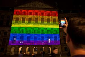 Amsterdam's Royal Palace is lit in the colors of the rainbow flag, to commemorate the victims of a shooting in a gay nightclub in Florida, in Amsterdam, Netherlands, Monday, June 13, 2016. (AP Photo/Peter Dejong)