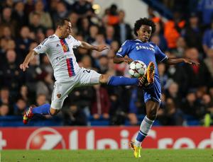LONDON, ENGLAND - SEPTEMBER 18:  Marcelo Diaz of FC Basel and Willian of Chelsea battle for the ball during the UEFA Champions League Group E Match between Chelsea and FC Basel at Stamford Bridge on September 18, 2013 in London, England.  (Photo by Ian Walton/Getty Images)