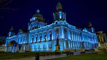 Belfast City Hall is illuminated blue to show support to NHS workers during the coronavirus pandemic in Belfast on March 26th 2020 (Photo by Kevin Scott for Belfast Telegraph)