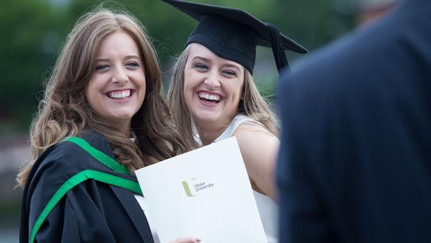 Zoe Brown from Bangor graduates with BSc Hons Computational Finance. Zoe is pictured with her sister Anne. (Photo: Nigel McDowell/Ulster University)