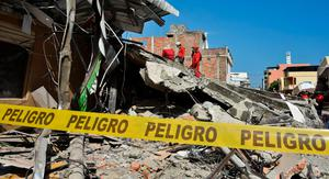 Peruvian rescuers work after a 7.8-magnitude quake at the Tarqui Neigborhood in Manta, Ecuador on April 18, 2016.  Rescuers and desperate families clawed through the rubble Monday to pull out survivors of an earthquake that killed 350 people and destroyed towns in a tourist area of Ecuador. / AFP PHOTO / LUIS ACOSTALUIS ACOSTA/AFP/Getty Images