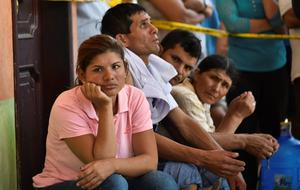 People wait for news of their loved ones in Manta, in the Ecuadorean coastal province of Manabi, on April 18, 2016 two days after a 7.8-magnitude quake hit the country. Rescuers and desperate families clawed through the rubble Monday to pull out survivors of an earthquake that killed 350 people and destroyed towns in a tourist area of Ecuador. / AFP PHOTO / LUIS ACOSTALUIS ACOSTA/AFP/Getty Images