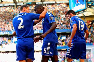 LONDON, ENGLAND - SEPTEMBER 19: Kurt Zouma (C) of Chelsea celebrates scoring his team's first goal with his team mate Branislav Ivanovic (L) and Diego Costa (R) during the Barclays Premier League match between Chelsea and Arsenal at Stamford Bridge on September 19, 2015 in London, United Kingdom.  (Photo by Ian Walton/Getty Images)