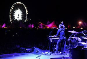 INDIO, CA - APRIL 13:  Musician Ben Gibbard of the band The Postal Service performs onstage during day 2 of the 2013 Coachella Valley Music & Arts Festival at the Empire Polo Club on April 13, 2013 in Indio, California.  (Photo by Kevin Winter/Getty Images for Coachella)