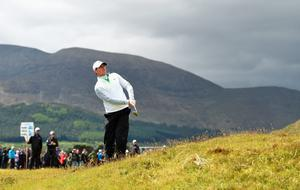 NEWCASTLE, NORTHERN IRELAND - MAY 29:  Rory McIlroy of Northern Ireland hits his 3rd shot on the 1st hole during the Second Round of the Dubai Duty Free Irish Open Hosted by the Rory Foundation at Royal County Down Golf Club on May 29, 2015 in Newcastle, Northern Ireland.  (Photo by Ross Kinnaird/Getty Images)