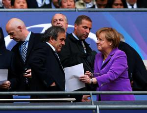 LONDON, ENGLAND - MAY 25:  (L-R) UEFA President Michel Platini and German Chancellor Angela Merkel prior to the UEFA Champions League final match between Borussia Dortmund and FC Bayern Muenchen at Wembley Stadium on May 25, 2013 in London, United Kingdom.  (Photo by Alex Livesey/Getty Images)