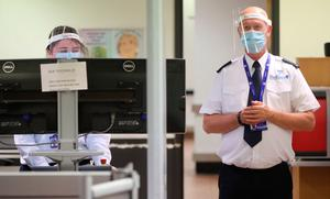 Security Staff members wear PPE at Belfast International Airport which reopens on Monday June 15th. PA Photo. Picture date: Thursday June 11, 2020. See PA story HEATH Coronavirus Ulster . Photo credit should read: Niall Carson/PA Wire
