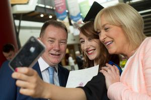 Rachel Cruickshank from Coalisland graduated the degree of BA Drama from Ulster University. She is pictured here with mum Brenda and dad Gavin. (Photo: Nigel McDowell/Ulster University)