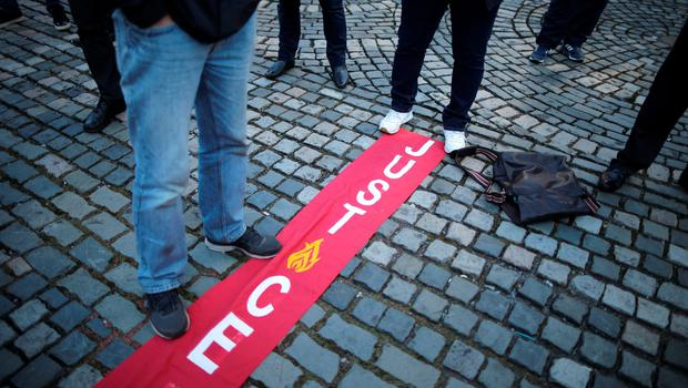 LIVERPOOL, ENGLAND - APRIL 27: A banner stating justice is laid out on the pavement outside Liverpool's Saint George's Hall as thousands of people gather to attend a vigil for the 96 victims of the Hillsborough tragedy on April 27, 2016 in Liverpool, England. The civic commemoration event marks the outcome of the fresh inquests into the 1989 Hillsborough disaster, in which 96 football supporters were crushed to death, and concluded yesterday with a verdict of unlawful killing. Relatives, Liverpool supporters and members of the public are taking part in the vigil at St George's Hall where a candle is lit for each of the 96 victims who lost their lives during a crush at the Hillsborough football ground in Sheffield, South Yorkshire in 1989..  (Photo by Christopher Furlong/Getty Images)