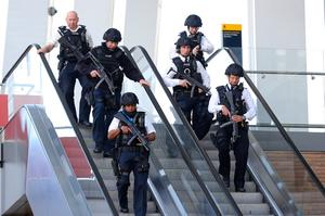 LONDON, ENGLAND - JUNE 04:  Armed Police are seen at London Bridge near the scene of last night's terrorist attack on June 4, 2017 in London, England. Police continue to cordon off an area after responding to terrorist attacks on London Bridge and Borough Market where 6 people were killed and at least 48 injured last night. Three attackers were shot dead by armed police.  (Photo by Christopher Furlong/Getty Images)