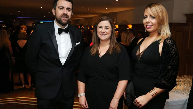 Ryan Quinn, Julie Moore and Sarah Stewart at the Institute of Directors NI Annual Dinner at the Europa Hotel on Thursday night. Sponsored by Bank of Ireland and Arthur Cox, the event is the highlight of the local business calendar and was attended by over 250 people.  Picture by Kelvin Boyes / Press Eye.