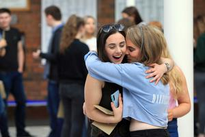 Students celebrate after getting their A-Level results at Banbridge Academy grammar school in Banbridge, Thursday, August 15, 2019. (Photo by Paul McErlane for the Belfast Telegraph)