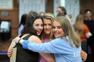 Renee Hamilton, Abbey Gillespie and Michelle Hamilton celebrate after getting their A-Level Results from Banbridge Academy grammar school in Banbridge, Thursday, August 15, 2019. (Photo by Paul McErlane for the Belfast Telegraph)