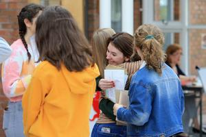 Students hug after getting their A-Level results from Banbridge Academy grammar school in Banbridge, Thursday, August 15, 2019. (Photo by Paul McErlane for the Belfast Telegraph)