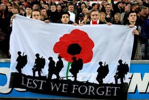 Fans in the stands with a remembrance day flag during the Barclays Premier League match at the Liberty Stadium, Swansea. Nick Potts/PA Wire.