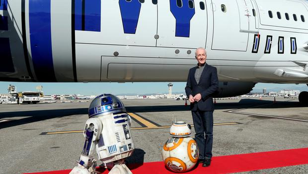 """LOS ANGELES, CA - DECEMBER 15:  Following the world premiere in Hollywood of Lucasfilms """"Star Wars: The Force Awakens"""", the film's stars were joined by J.J. Abrams and producer/Lucasfilm president Kathleen Kennedy for a chartered flight from Los Angeles to the London premiere of the movie on a custom, one of a kind, specially themed R2-D2 ANA JET. Earlier at the premiere, stars posed for photos with a scale model of ANAs BB-8-themed ANA JET. ANA, Japans largest airline, has designed three Star Wars-themed jets in celebration of Star Wars: The Force Awakens. The R2-D2 ANA JET is the first ever aircraft in the world to feature a Star Wars character on its exterior and is a product of an agreement between ANA and The Walt Disney Company (Japan) Ltd. First unveiled at the Star Wars Celebration in Anaheim, Calif. earlier this year, the R2-D2 ANA JET, a Boeing 787-9, started its regular flight in October and now flies to various destinations, including Europe, Asia, China and the U.S. December 15, 2015 in Los Angeles, California.  (Photo by Jesse Grant/Getty Images for Disney)"""