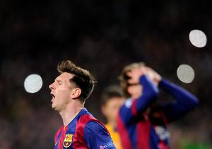 Barcelona's Lionel Messi, left, and Barcelona's Ivan Rakitic, right, react during a Champions League round of 16 second leg, soccer match between FC Barcelona and Manchester City at Camp Nou stadium, in Barcelona, Spain, Wednesday, March 18, 2015. (AP Photo/Manu Fernandez)