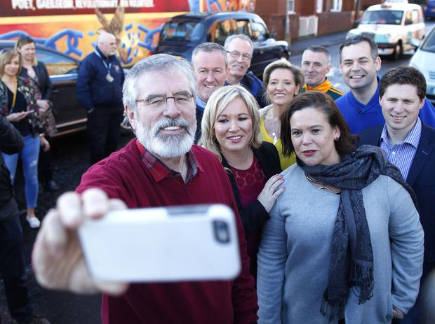Press Eye - Belfast - Northern Ireland - 4 March 2017 - Sinn Fein's leadership team , Michelle O'Neill, Mary Lou McDonald and Gerry Adams take a selfie following a press conference on the Falls road in West Belfast.  Photo by Peter Morrison / PressEye