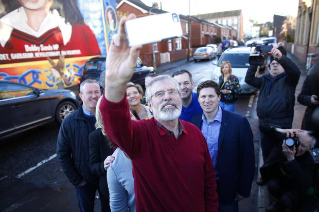 Press Eye - Belfast - Northern Ireland - 4 March 2017 - Sinn Fein leader Gerry Adams take a selfie following a press conference on the Falls road in West Belfast.  Photo by Peter Morrison / PressEye