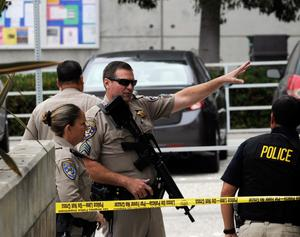 SANTA MONICA, CA - JUNE 07:  California Highway Patrol Officers contain a scene at Santa Monica College after multiple shootings were reported on the campus June 7, 2013 in Santa Monica, California.  According to reports, at least one person has died, four people hospitalized, and a suspect was taken into custody. (Photo by Kevork Djansezian/Getty Images)