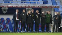 Republic of Ireland head coach Stephen Kenny (left) and his staff watch the penalty shoot-out in Bratislava (Martin Baumann/PA)