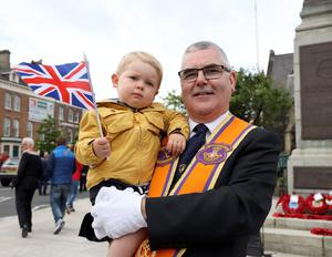 PACEMAKER PRESS BELFAST  13/7/2020 Twelfth of July celebrations in Portadown today. People were encouraged to celebrate the Twelfth from home due to coronavirus. The Orange Order were not parading today, however, a small number of local lodges took part in a Remembrance Service at Portadown Cenotaph.  Pictured Nigel Mulholland and nephew Archie Madill. Photo Pacemaker Press