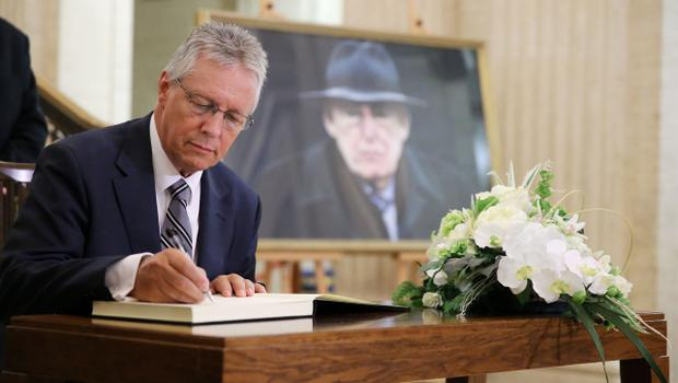 Press Eye - Belfast - Northern Ireland - 15th September 2014 - Picture by Kelvin Boyes / Press Eye.  First Minister Peter Robinson  signs a book of condolence at in the Great Hall at Parliament Buildings, Stormont, Belfast, in memory of former DUP leader and First Minister Rev Ian Paisley.   The funeral of Ian Paisley, the former Democratic Unionist Party leader and first minister of Northern Ireland, will take place this week.